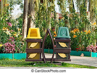 trashcan - Green and yellow bins put in a steel frame with...