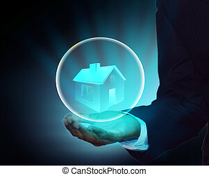 Own house and protect home concept - Business man holding a...