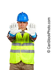 Construction worker with gloves, order to stop -...