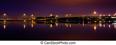 Lights and highways reflecting in the Potomac River at...