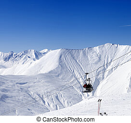 Skiers on ropeway at ski resort Gudauri at nice day Georgia,...