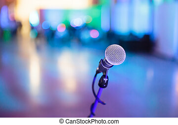 Microphone with blurred party stage around - Microphone with...