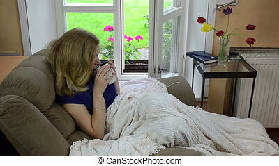 woman rug hot drink tea - Girl lie under rug wrap on...