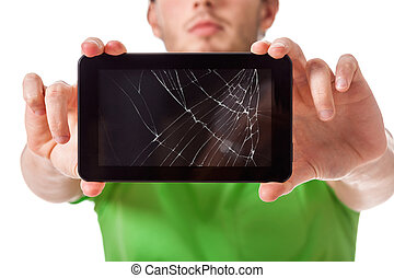 Young man holding broken tablet - Student presenting a...