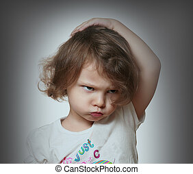 Angry kid on grey background Closeup portrait