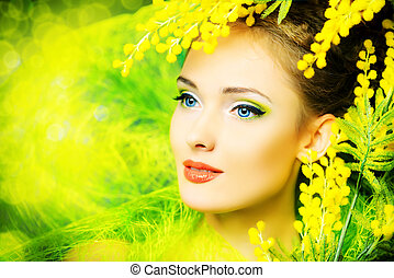 gentle smile - Portrait of a beautiful girl with mimosa...