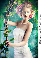 fairy garden - Beautiful young woman standing under an arch...