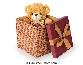 Teddy bear in a gift box on white background