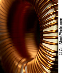 inductor detail - detail of a electronic conductor in dark...