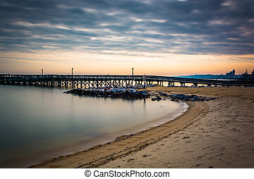 Long exposure of the beach and a pier in the Chesapeake Bay,...