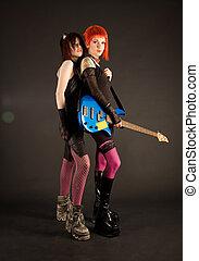 Rock girls with bass guitar