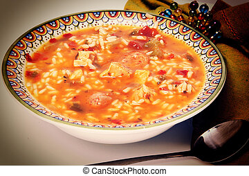 Cajun Chicken and Sausage Gumbo in a bowl with spoon and...