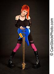 Romantic rock girl with bass guitar