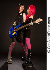 Two rock girls with bass guitar