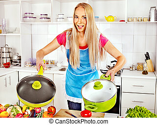 Woman preparing food at kitchen - Happy woman preparing food...
