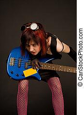 Sensual rock girl with bass guitar