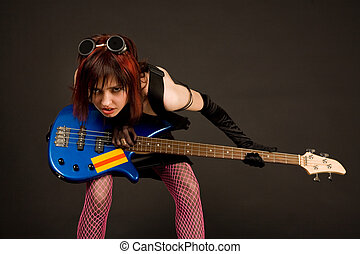 Rock girl with bass guitar - Rock girl in crazy outfit with...