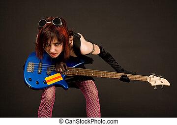 Rock girl with bass guitar