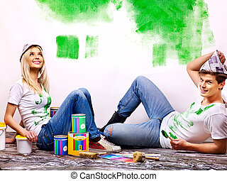 Family paint wall at home. - Happy family paint wall at...