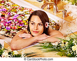 Woman at luxury spa. - Woman relaxing at water spa.