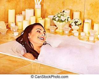 Woman relaxing at bubble bath - Woman relaxing at water in...