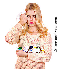 Young woman having flu takes pills.