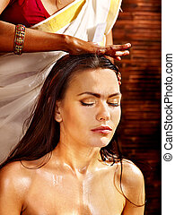 Woman having ayurveda spa treatment - Young woman having...