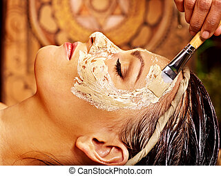 Woman having mask at ayurveda spa - Woman having facial mask...