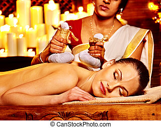 Woman having massage with pouch of rice - Woman having...