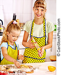 Child with rolling-pin dough