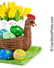 easter eggs in basket with flowers