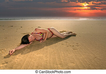 woman resting on beach