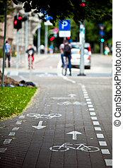 Bike lane signal - White bicycle on cycle way. Bike lane...