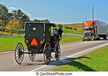 Amish Buggy and Semi Share the Road - An Amish buggy shares...