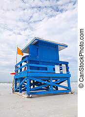 Siesta Key Beach, Florida USA, colorful lifeguard house on a beautiful summer day with ocean and blue cloudy sky