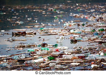 ruined environment - many plastic bottles and trash floating...
