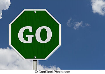 Go Sign, An American road sign and words Go with blue sky