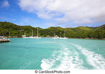 Island Praslin - Yacht in sea around Island Praslin -...