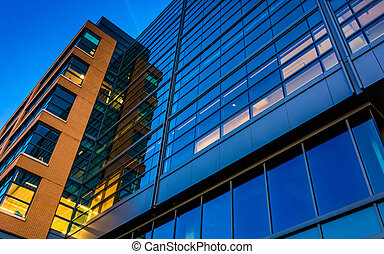 Modern glass building at twilight, in Baltimore, Maryland