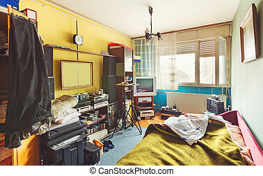 Messy room interior, a lot of different stuff, from...