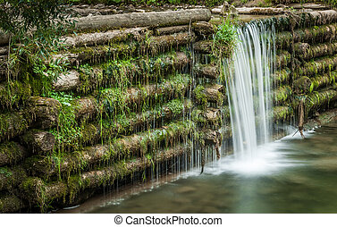 man made waterfall - creek and man made waterfall in the...