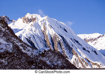 windy snowy peak - A mountain peak full of snow and ruffled...