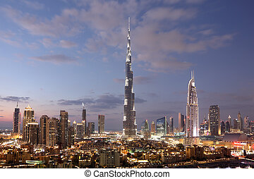 Burj Khalifa and Dubai Downtown at dusk. United Arab...