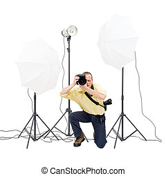 Studio photographer - A professional photographer in a...