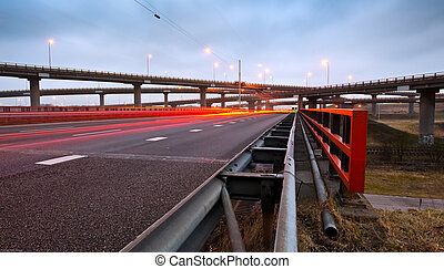Highway Overpass - A highway overpass with busy traffic at...