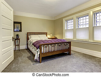 Classic bedroom with brown wooden bed