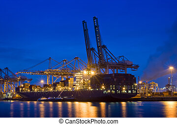 Container terminal at night - The activity of loading and...