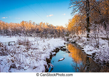 Stream in a snow covered meadow, in rural York County,...