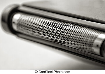Electric shaver. - Grid cells with electric razor close up.