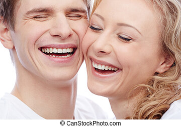 Joyful couple - Faces of amorous young couple laughing with...